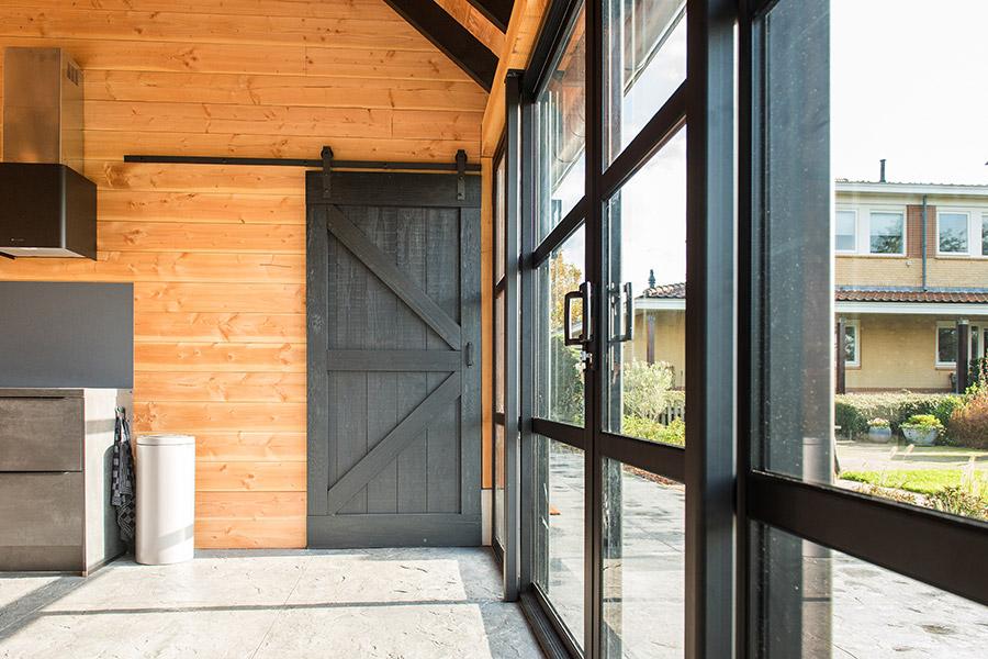 Wat kost een houten buitenverblijf